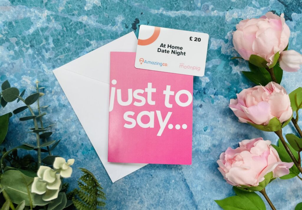 Pink 'just to say' card with a white voucher on a blue background for Valentine's Day in lockdown