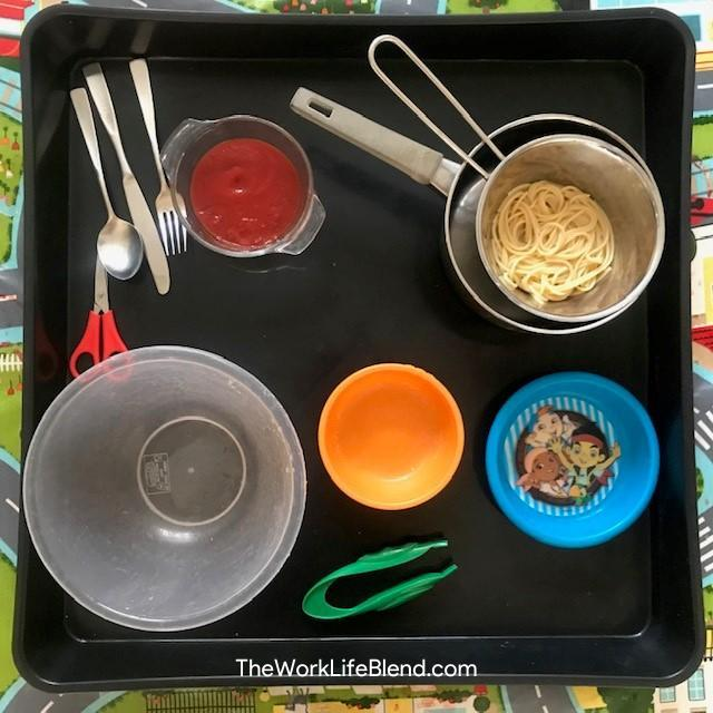 A tuff tray with various bowls on it for an activity to do in half term in lockdown