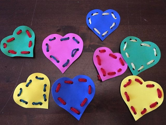 Colourful heart shaped cards with wool threaded through