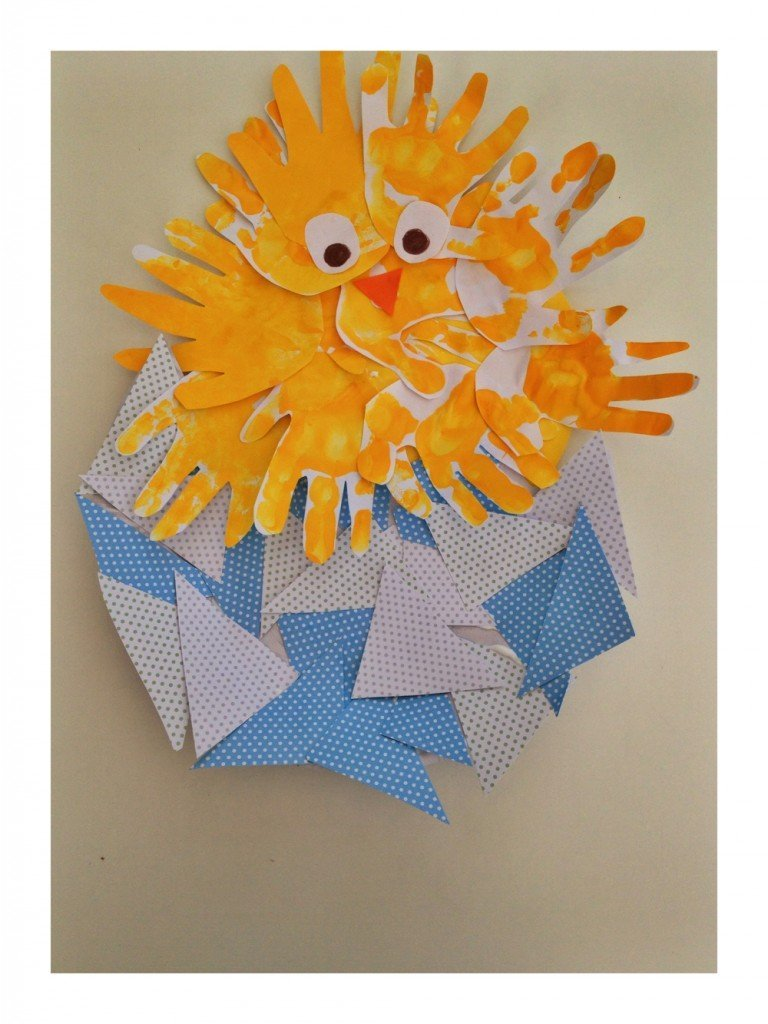 An easter chick made out of a child's handprint and painted yellow
