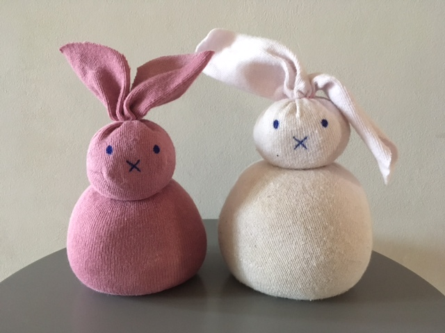 Two pink bunnies made out of socks filled with rice