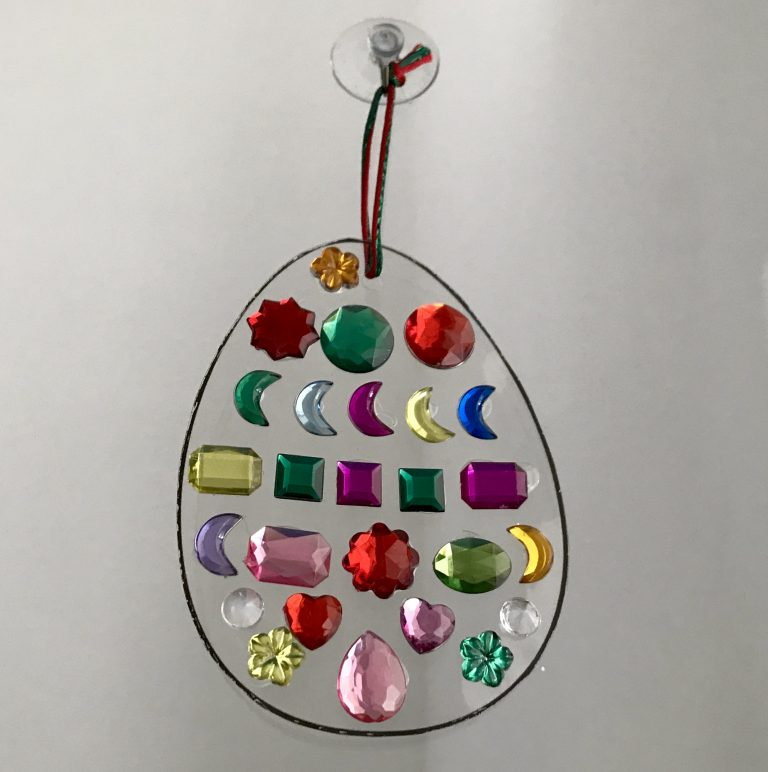 An easter egg suncatcher with different coloured jewels is a great easter craft idea for kids