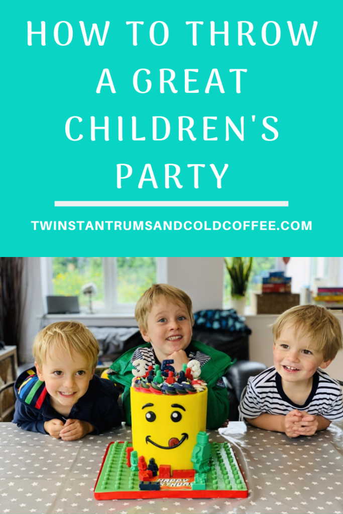 How to throw a children's birthday party PIN with three boys looking at a lego cake