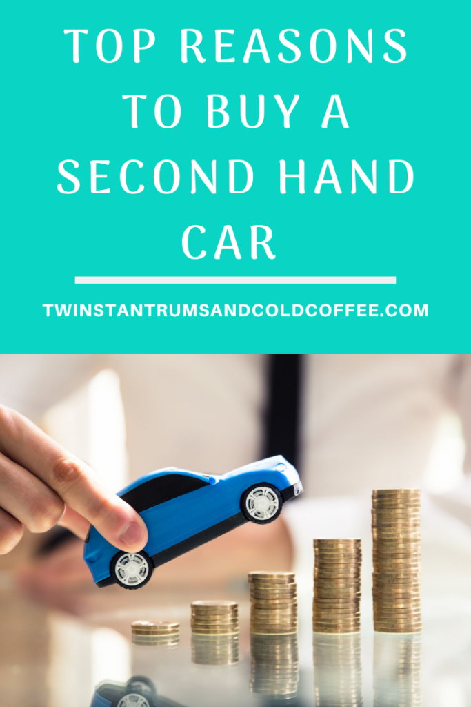 A blue toy car and some coins for a post on reasons to buy a second hand car