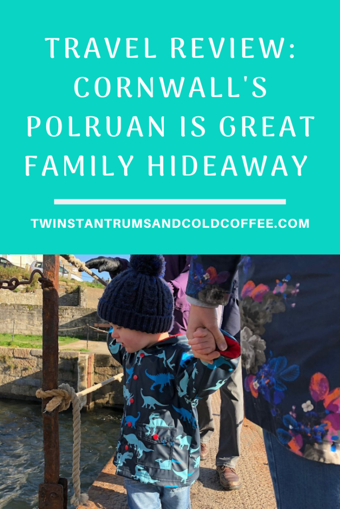 Toddler in woolly hat on holiday in Polruan