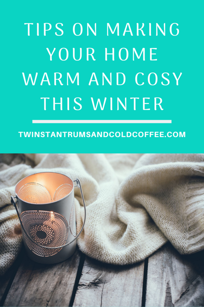 A candle and blanket on a surface as a way of making your home warm and cosy this winter