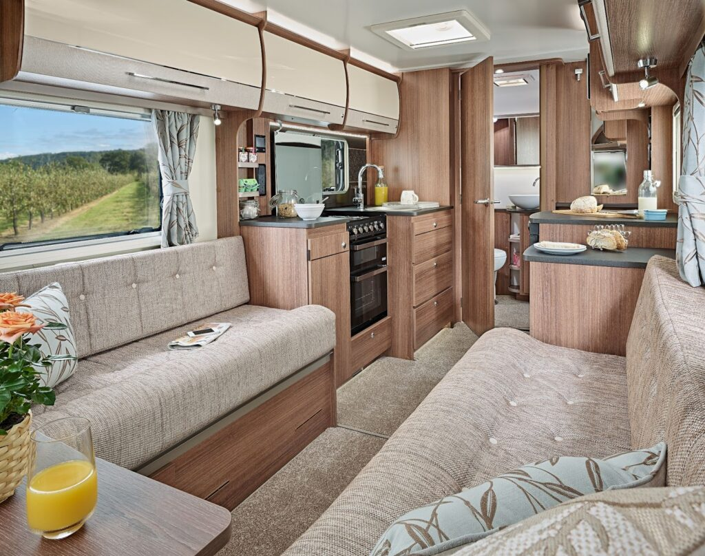 Inside a caravan showing the living area and kitchen