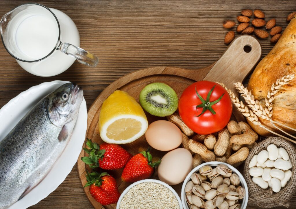 plate of nuts, eggs, fish and fruit that could cause allergies