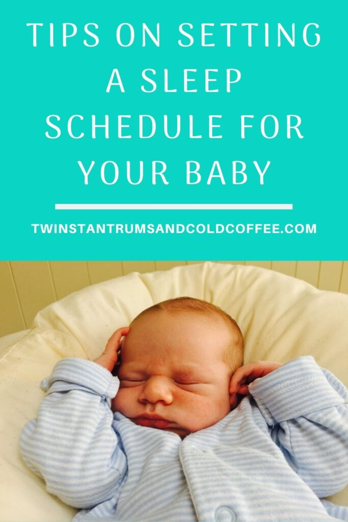 Tips on setting a sleep schedule for your baby, and a little boy asleep with his arms up around his head