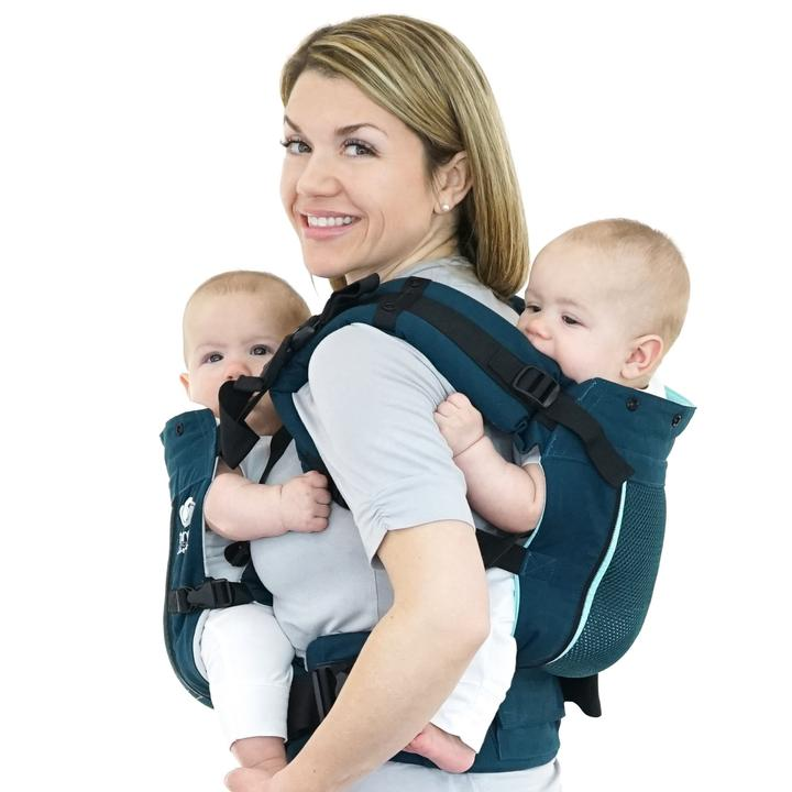 A TwinGo double baby carrier will help when travelling with twins