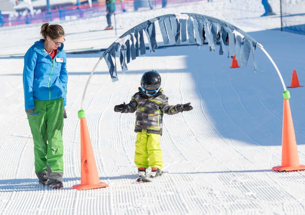Ski instructor helps a three year old learn to ski for a piece about a ski holiday in Japan
