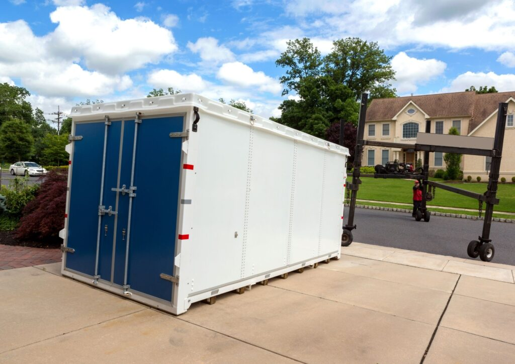 A portable storage unit on a driveway