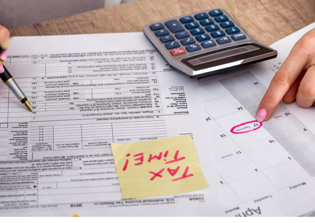 Paperwork and calculator ready for filing your taxes