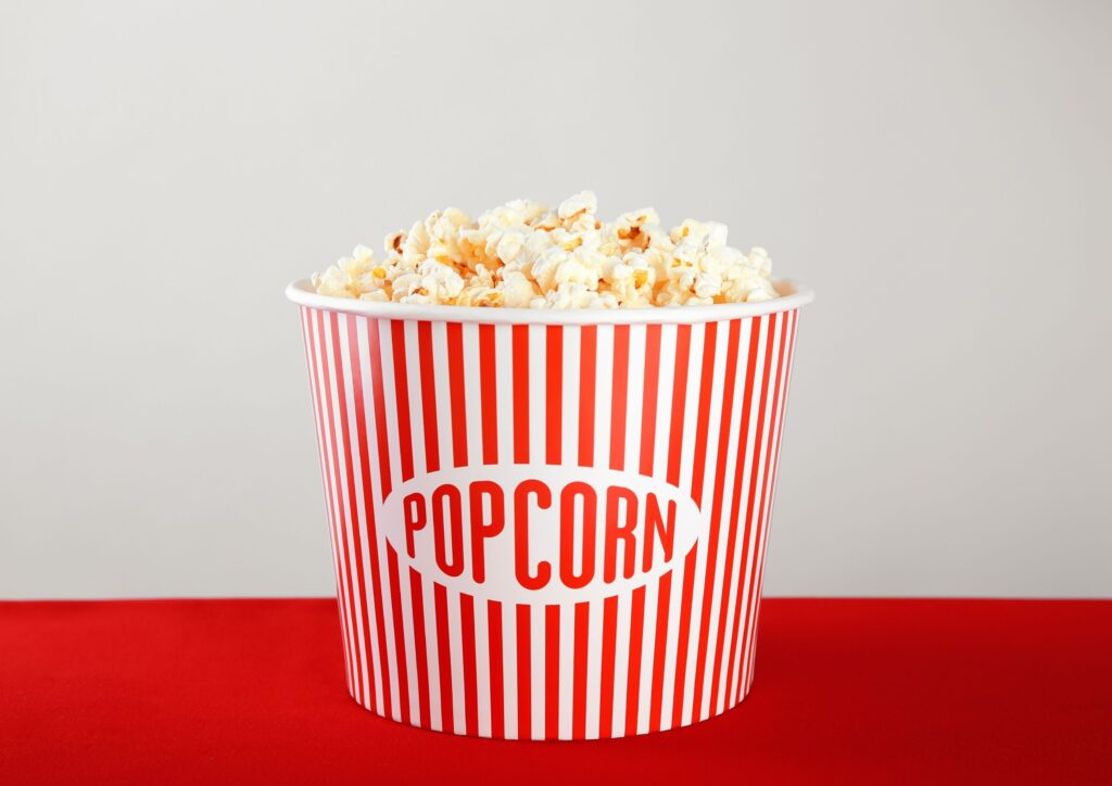 A red and white stripy bucket of popcorn