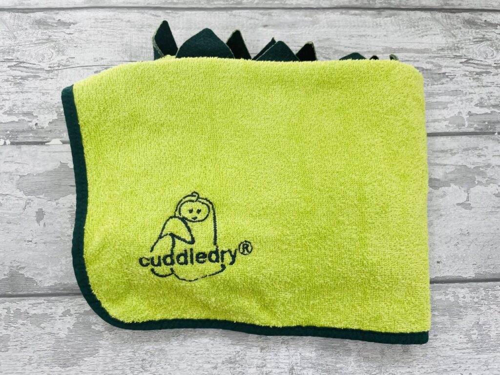 Green Cuddledry towel folded to show off its embroidered logo