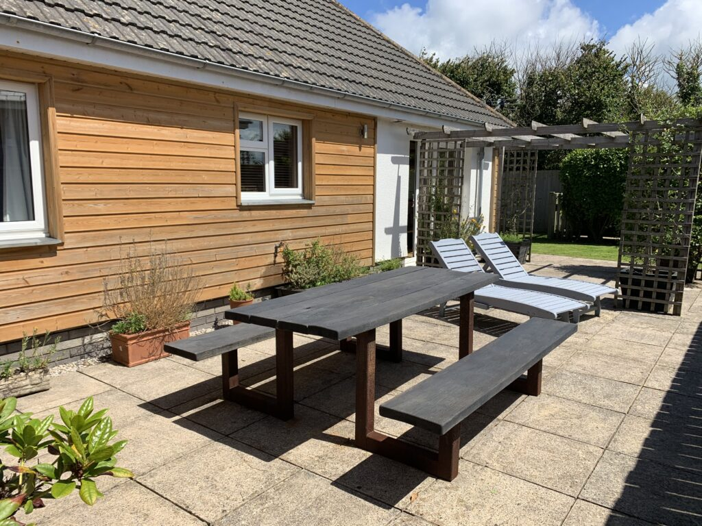 Sun loungers on a patio at a holiday home in north cornwall