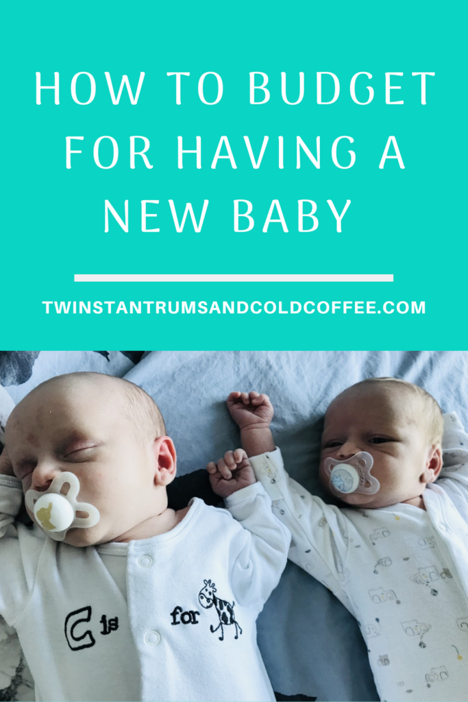 PIN for how to budget for having a new baby with newborn twins asleep on a bed