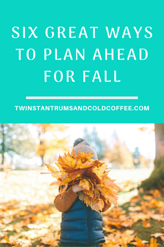 how to plan ahead for fall, with a boy hiding behind a bunch of golden leaves