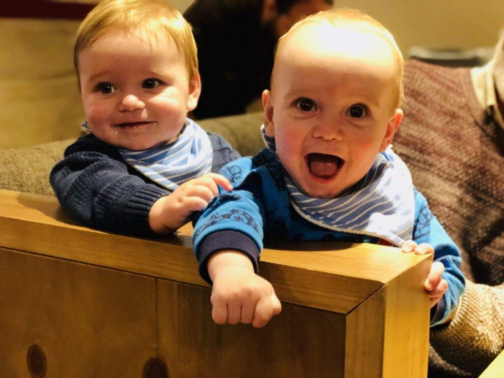 Nine month old twins in a cafe