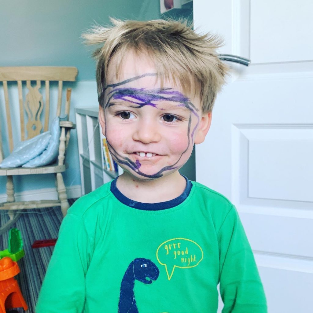 Toddler with felt tip pen all over his face during lockdown