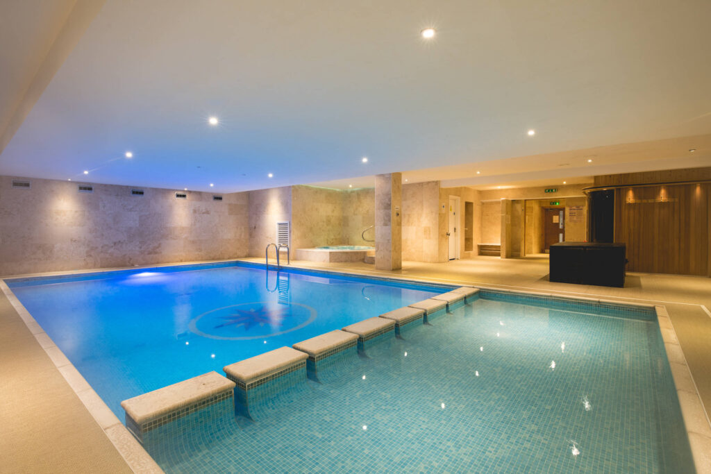 A swimming pool, splash pool and hot tub at the Esplanade hotel in Cornwall