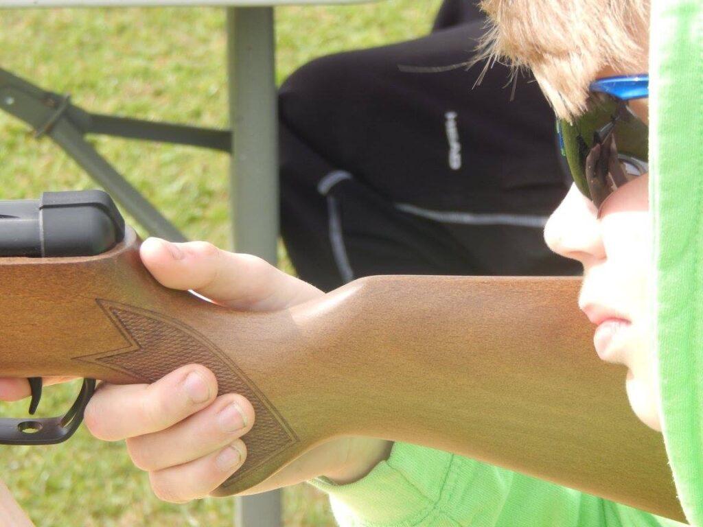 A boy holds a gun at a holiday club
