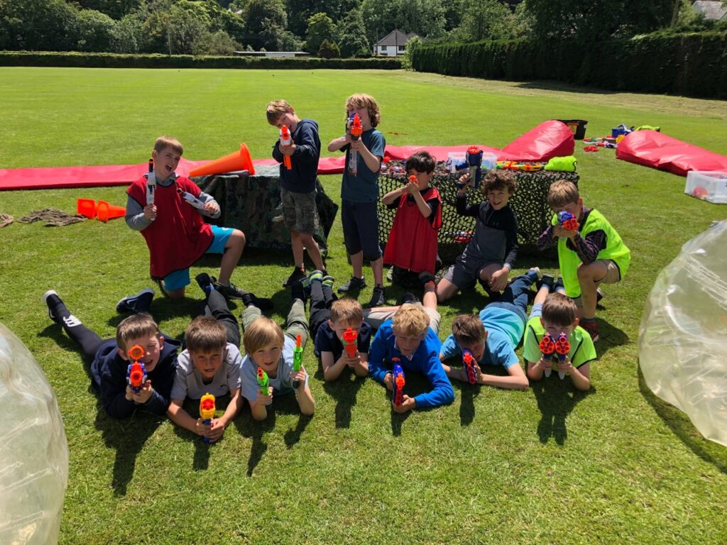 Children hold nerf guns at High 5 summer camp in Plymouth