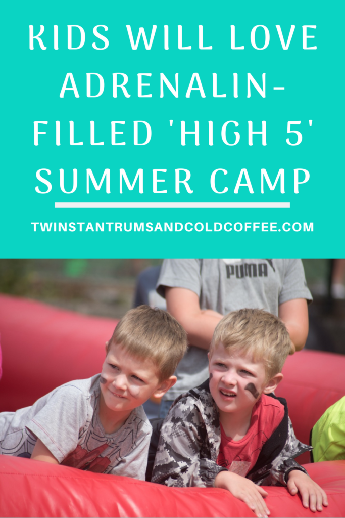 PIN image for high 5 summer camp with a pic of two brothers leaning on the side of a red inflatable