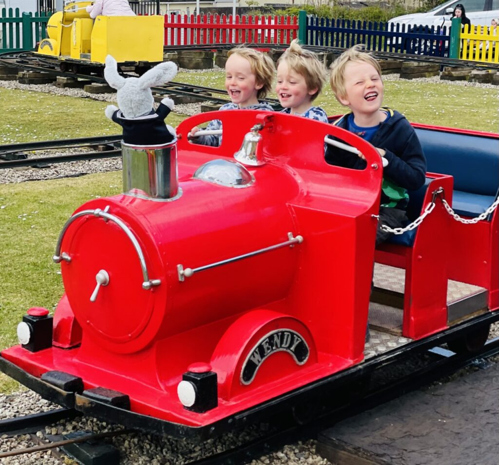 Three brothers on the Gus Honeybun train at West Hoe Park in Plymouth