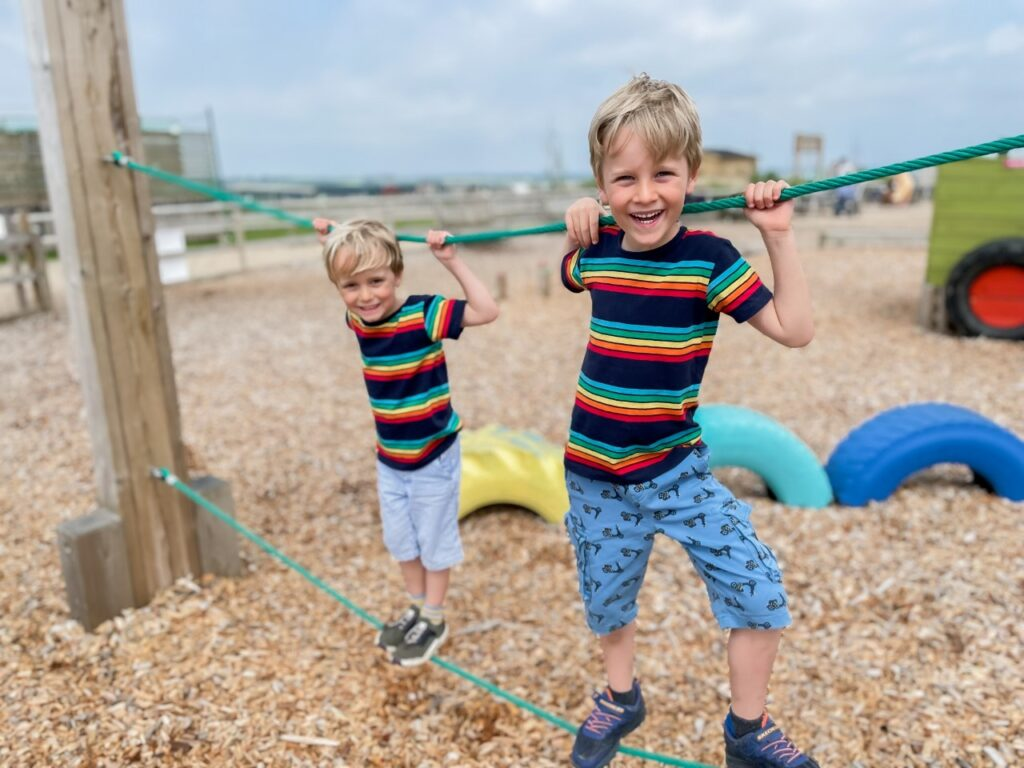 Blonde brothers on a trim trail at Tapnell Farm Park