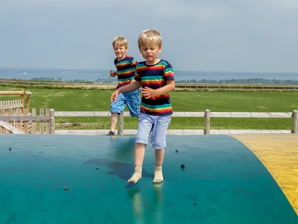Brothers on a jumping pillow at Tapnell Farm Park