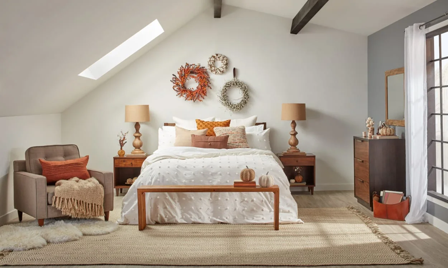Autumn inspired wreaths above a bed are ideal if you're updating your bedroom for the autumn season