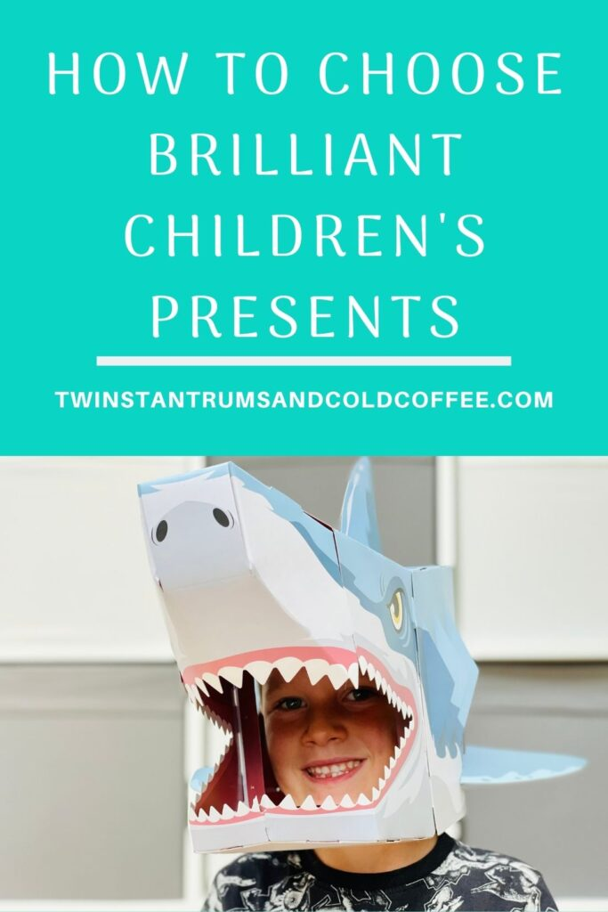 PIN image of a boy in a cardboard shark mask from Wicked Uncle