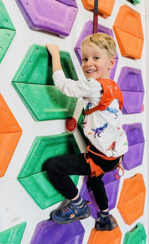 Five year old boy on a climbing wall at Clip n Climb in Plymouth