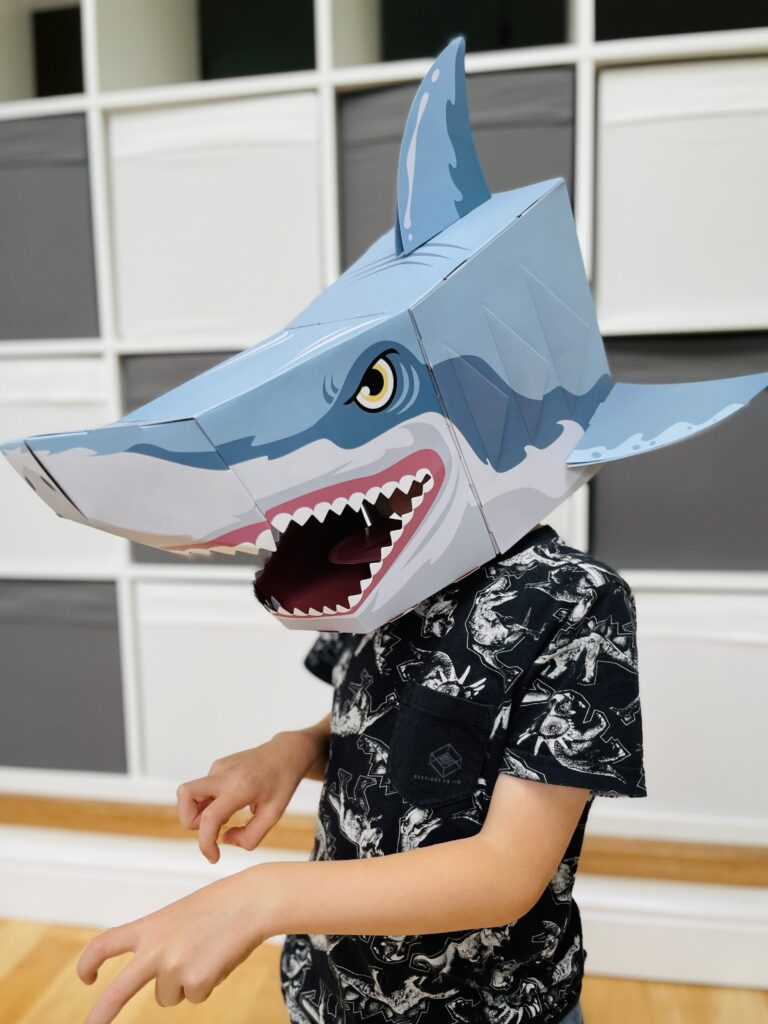 Six year old boy wearing a 3d shark mask from wicked uncle