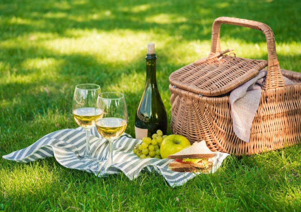 A picnic basket with wine to celebrate a wedding anniversary