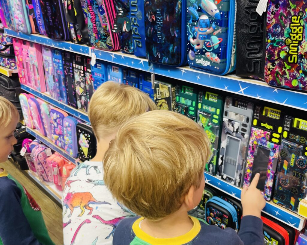 Brothers look at products in Smiggle at Drake Circus in Plymouth