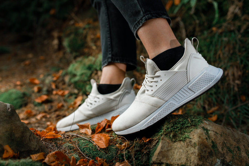 Close up of white sneakers by Loom footwear on
