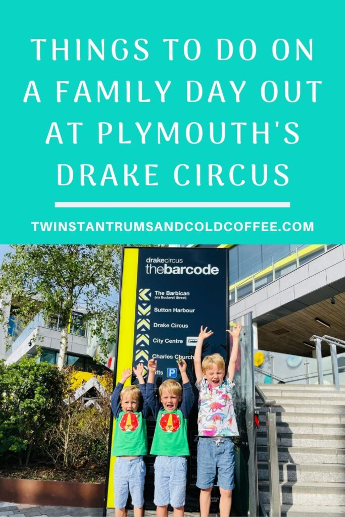 Pin image of Brothers cheering by a poster for the Barcode at Drake Circus