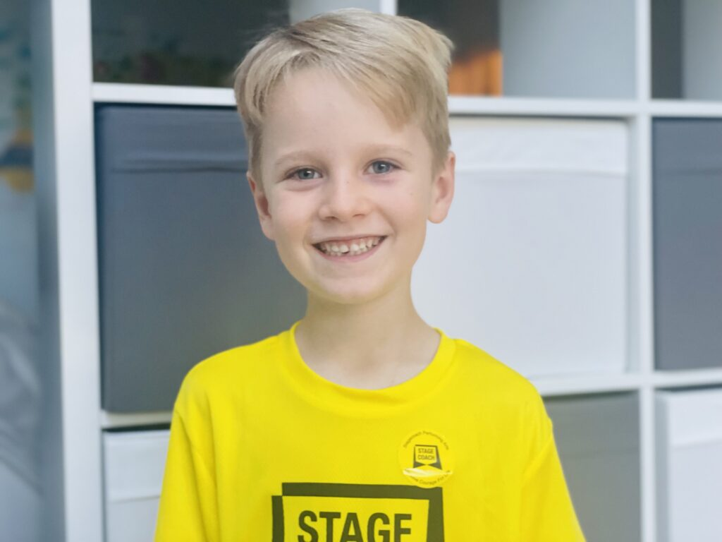 Six year old boy wearing a yellow Stagecoach t.shirt