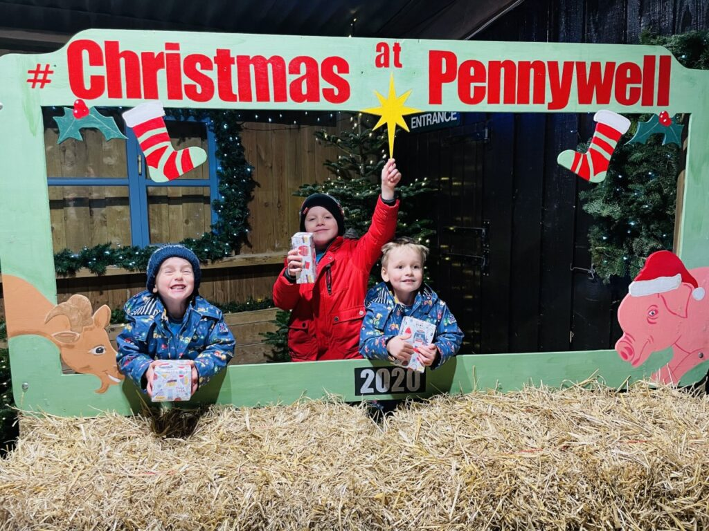 Brothers with presents after going to a Christmas experience at Pennywell